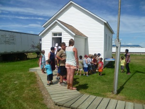 Ringing the Big Bell at the School House